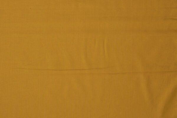 Katoen doek op rol okergeel